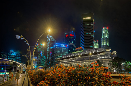 distinctive: SINGAPORE - CIRCA JAN 2015: Distinctive Modern Architecture of Singapores Night Time Skyline Editorial
