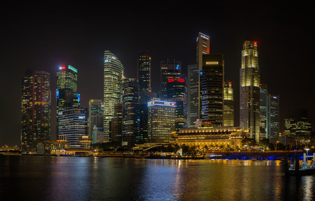marina life: SINGAPORE - CIRCA JAN 2015: business center of the city. Skyscrapers in night lights Editorial