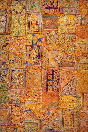 oriental rug: Tapestry in authentic Indian style. Ethnic homemade vertical background. Jaisalmer, Rajasthan, India.