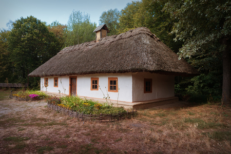 Ukraine, Kiev, Pirogovo. Traditional ukrainian old house with straw roof