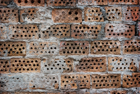 structured: Wall of the holey brick, background texture