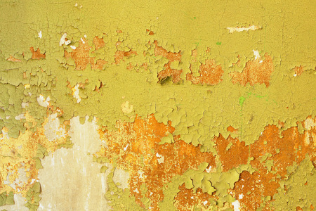 Dirty background - wall of an abandoned building with damaged green paint Stock Photo