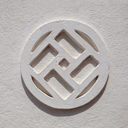 Sri Lanka - pattern on the grey wall in the shape of a swastika