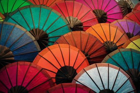 paper umbrella: Colorful traditional paper umbrellas on the market. Laos, Luang Prabang