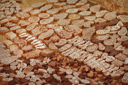 typescript: Wooden printing blocks hand carved by artisans in India. Trade at the Pushkar fair