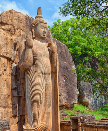 The Avukana statue is a standing statue of the Buddha. Sri Lanka. Vertical shot Stock Photo
