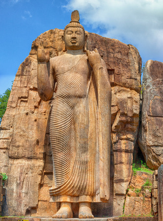 Big Buddha statue carved out of the rock near Aukana temple. Sri Lanka, Anuradhapura