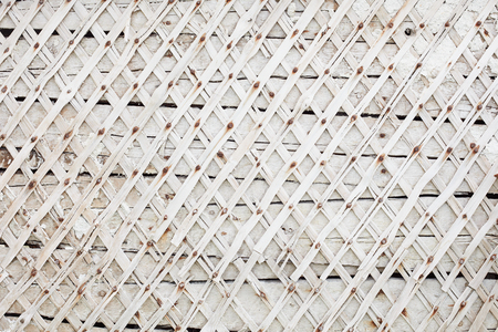 nailed: Wall with planks nailed. Rhombuses pattern. Background white wall