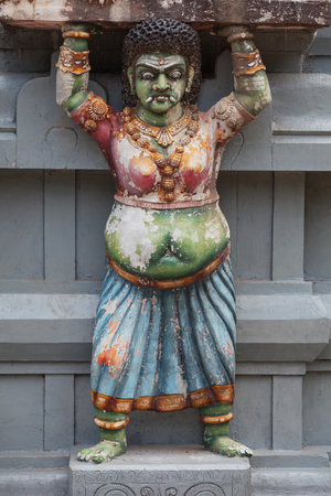 Sri Lanka. Decoration on the temple wall. Some asian ethnic statue