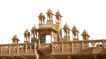 Ornate and intricately sculptured architectural details of a gate at Jaisalmer Fort in India, isolated against a white background.