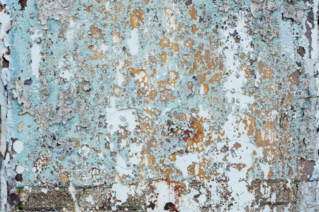 Dirty background - wall of an abandoned building with old paint