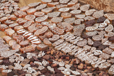 Wooden printing blocks hand carved by artisans in India. Trade at the Pushkar fair