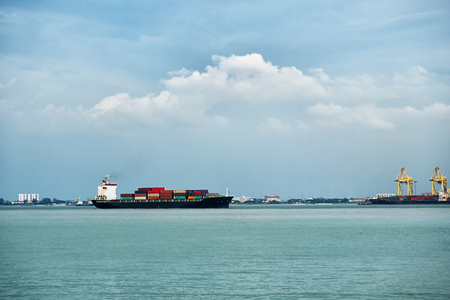 Big cargo ship with containers near the port in Penang, Malaysia Standard-Bild - 90361744
