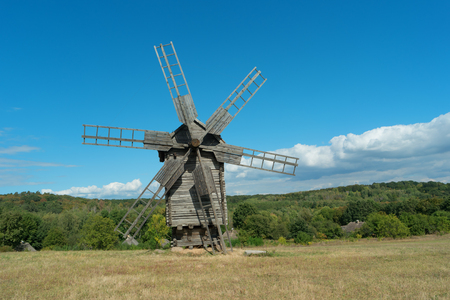 Old fashioned wooden wind mill. Ukraine, Kiev, Porogovo
