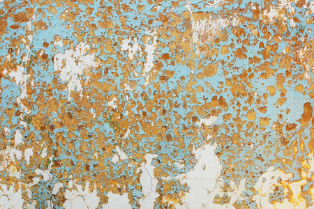 The surface of the wall are covered with old shabby paint background
