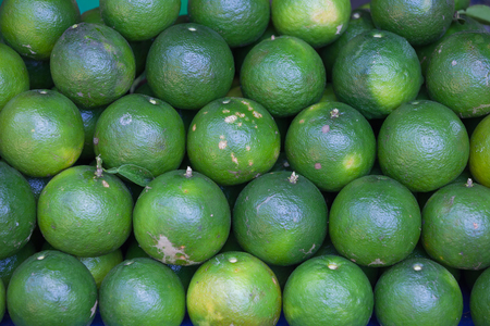 Limes on market fruit stall. Food background
