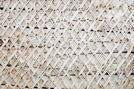Wall with planks nailed. Rhombuses pattern. Background white wall Standard-Bild - 90252756