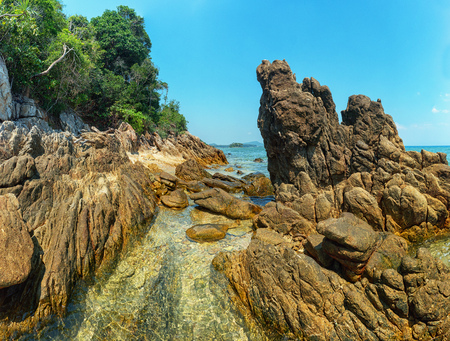 Thailand, Phuket. Rocks on the coast. Clear water and trees on the shore Stok Fotoğraf