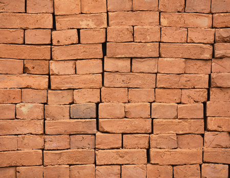 Stack of new red bricks. Architectural and construction background