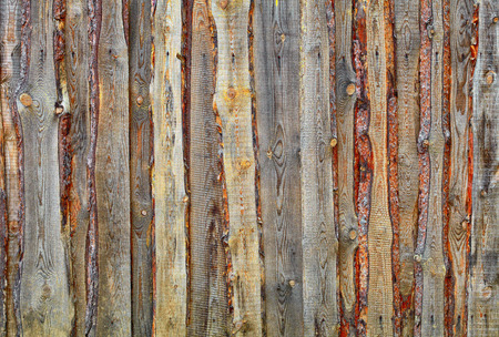Substandard fence of  boards and slabs - background