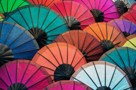 Colorful traditional paper umbrellas on the market. Laos, Luang Prabang
