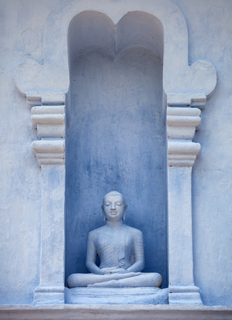Sri Lanka, Anuradhapura. Old Buddha Statue in the Exterior of the Temple