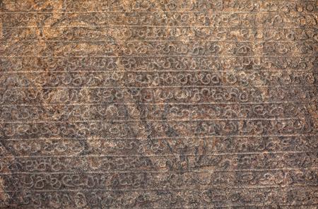 Ancient inscriptions on a huge stone slab. Sri Lanka, Anuradhapura.