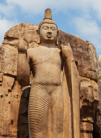 Avukana statue is a standing statue of the Buddha. Sri Lanka, Kekirawa. Vertical shot Standard-Bild - 90593507