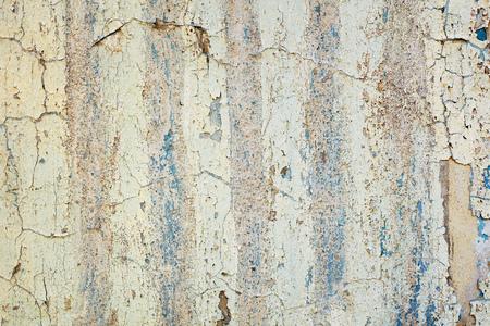 Peeling white wall. Grunge background. Texture