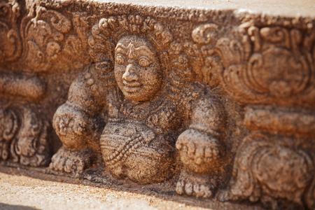 Sri Lanka, Anuradhapura. Mythological character on a stone wall of a temple close-up