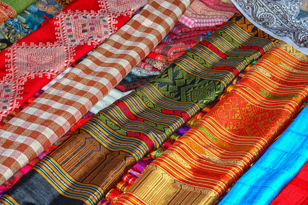 The multi-colored cloth on the counter of the store. Laos