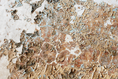 Disgusting old paint on the wall of the destroyed building - background