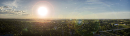 aerial photograph: Aerial photograph with lens flare of the sun rising in South Dakota.