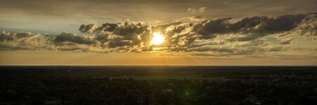 aerial photograph: An Aerial photograph of the Sun rising through the clouds remnants of a storm taken from 200 feet above ground with a UAV, ( Drone ) in South Dakota.