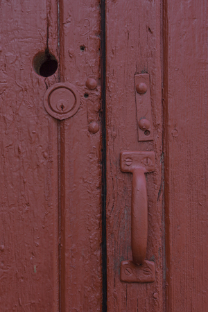 A thckly painted red door.