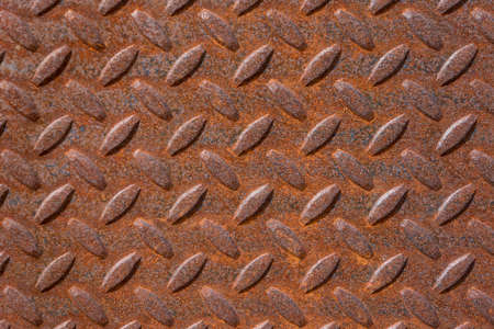 Rusty steel surface with anti slip pattern
