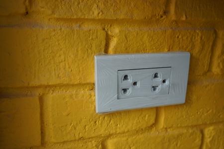 Plug on brick wall