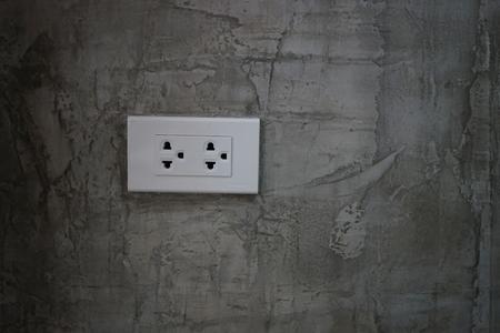 Plug on black wall