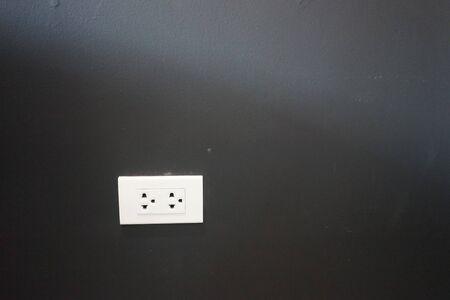 plugs on black wall