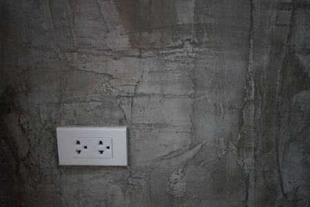 plugs on grey wall