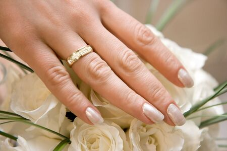 Photo of a wedding ring with jewels on a hand of the bride photo