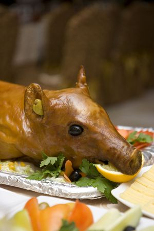 Fried pig on the table served by a holiday photo