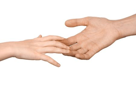 The mans hand holds a hand of the child on a white background Stock Photo