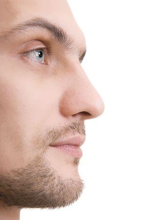 白い背景の上のプロファイルで青い目を持つ男の顔 写真素材