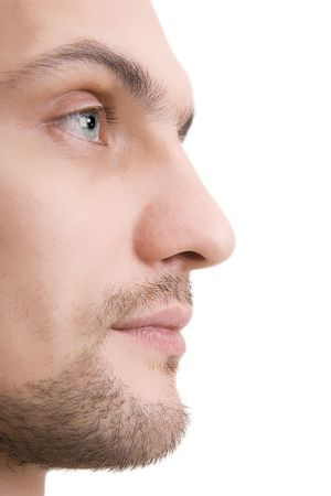side profiles: Mans face with blue eyes in a profile on a white background