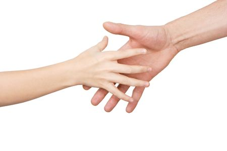 The palm of the child reaches for a hand of the man on a white background