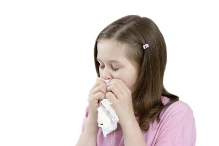 catarrh: The little girl with a handkerchief on a white background Stock Photo
