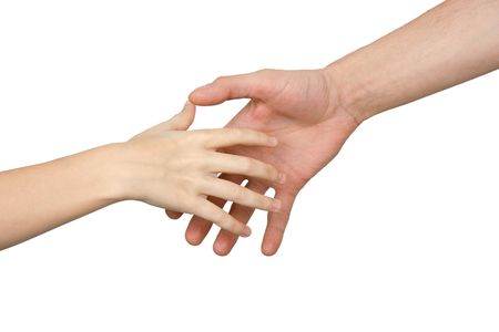 The palm of the child reaches for a hand of the man on a white background Stock Photo - 6070507