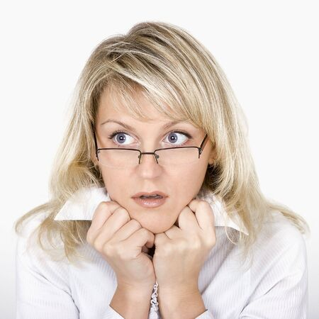 uncombed: The uncombed scared business young woman in glasses Stock Photo