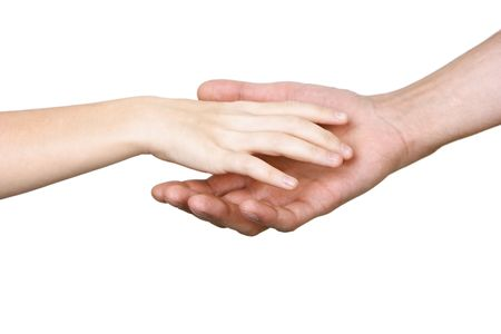 The palm of the child reaches for a hand of the man on a white background photo